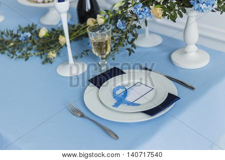Decorated wedding banquet table with name card, serenity color