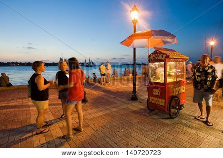 KEY WEST FLORIDA USA - MAY 03 2016: Tourists are relaxing in the twilight on Mallory Square in Key West in Florida.