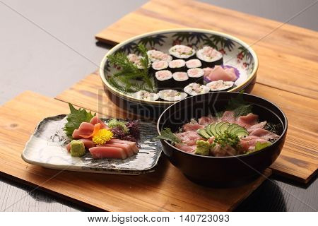 Tuna cuisine in Japanese style on wooden tray in restaurant