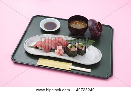 Trau meal of sushi and miso soup in Japanese style in white background