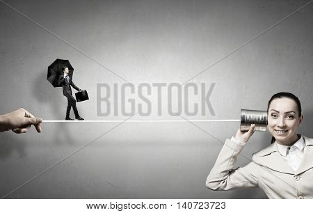 Woman using deaf phone . Mixed media