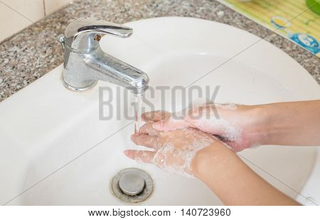 Washing on hands. Cleaning hands with soap.