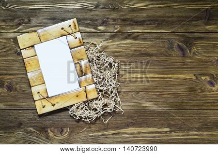 Wonderful bamboo frame on a wooden background.