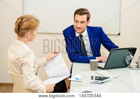 Business partners lead the discussion at the meeting. Everyday work in the company.
