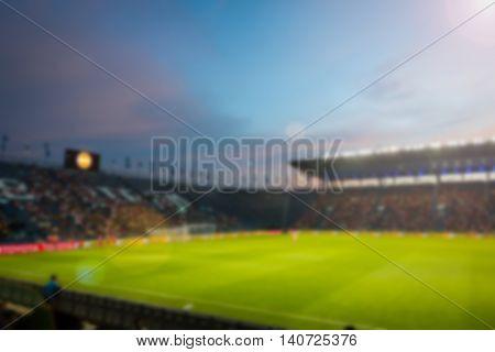 Blurry de-focused at stadium background on twilight.
