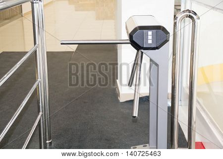 The tripod turnstile with electronic card reader is closed. of asecurity turnstile. Isometric turnstile. Isometric security barrier. Empty closed turnstiles. Tripod turnstile for entrance