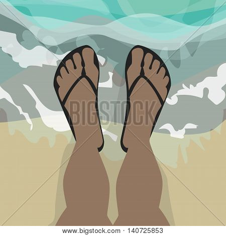 Feet in shales standing in sea water african american