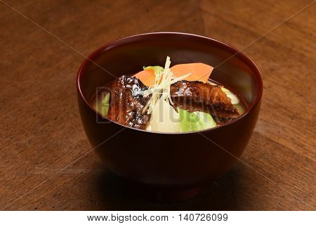 Japanese seerfish with Teriyaki soup in traditional bowl