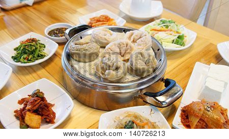 Korean Wangmandu of meat dumplings kimchi dumplings are served with a deliciously smooth