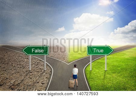 Businessman concept False or True road to the correct way.