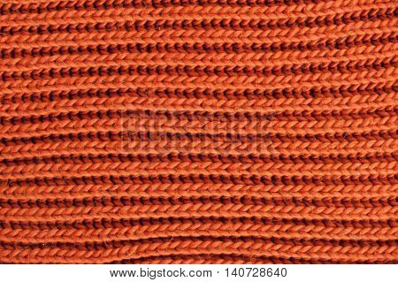 Orange knitted texture. Wool yarn in knitting background.