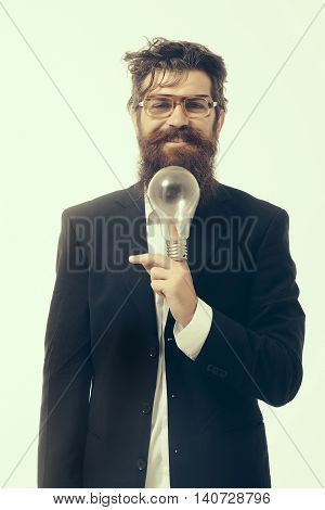 young handsome bearded man scientist or professor in glasses with long beard holding lamp isolated on white background einstein formula