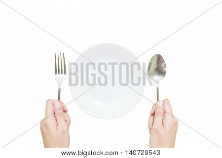 Closeup white ceramic dish with stainless fork and spoon in woman hand in top view isolated on white background with clipping path