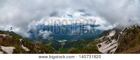Large cumulus clouds over the mountains of the Caucasus Mountains panorama