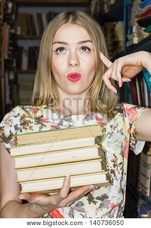 The Girl At The Library With Books Expressing Emotion Surprise Stack Of Books Holding