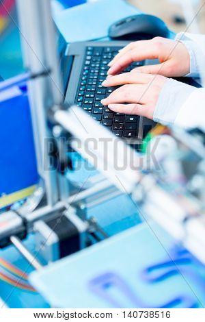 cnc router machine programming on computer keyboard