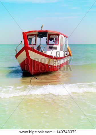 Tourist boat anchored on a beach in Thailand, Penang.