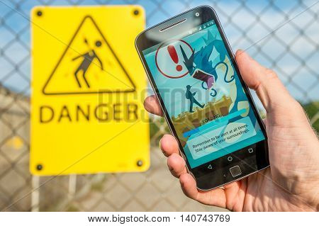 Montreal CA - July 27 2016: Closeup of the loading screen of the videogame Pokemon Go remembering players to be alert. Pokemon Go is a virtual reality game released in July 2016.