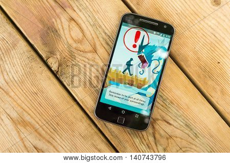 Montreal CA - July 28 2016: Closeup of the loading screen of the videogame Pokemon Go remembering players to be alert. Pokemon Go is a virtual reality game released in July 2016.