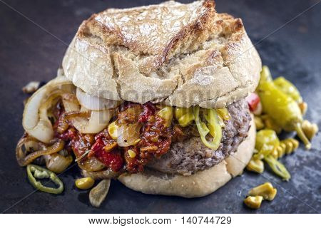 Hamburger with Chili Relish on old Metal Sheet