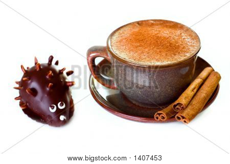 Coffee And Cinnamon With Cake In The Shape Of  Hedgehog