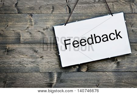 Feedback message on wooden table