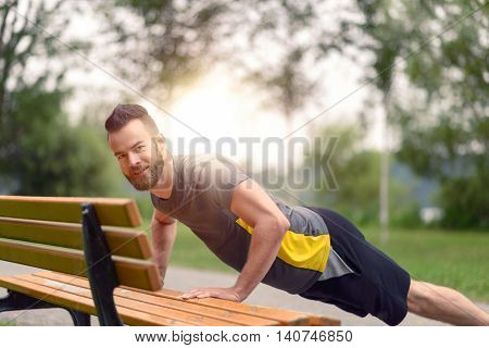 Young Man Working Out Doing Push-ups