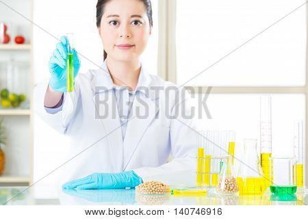Asian Female Scientist Working On Plant Biology