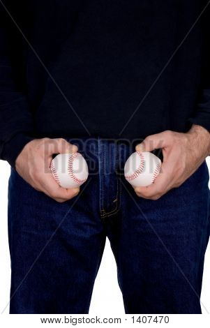 Man Holding Two Baseballs