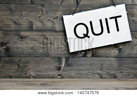 Quit message on wooden table
