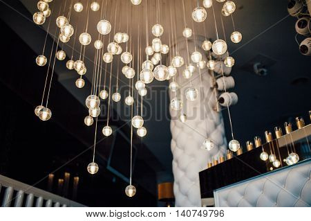 modern glass chandelier premium to the ceiling with light flares