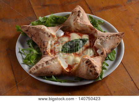 Original Italian pizza star form dish.
