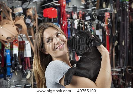 Customer Looking Away While Carrying French Bulldog In Store