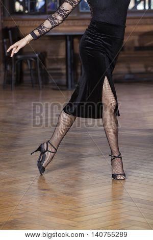 Low Section Of Woman Performing Tango On Hardwood Floor