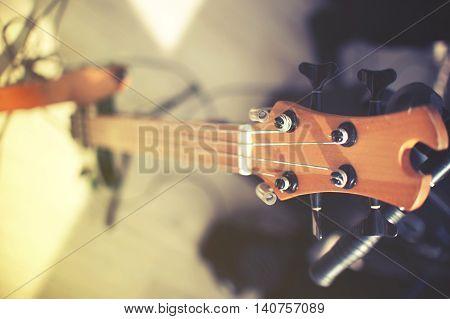 closeup of electrical bass guitar. vintage effect