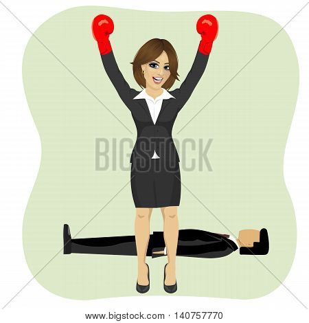 Success business woman cheering with raised arms wearing boxing gloves in front of man lying on the floor