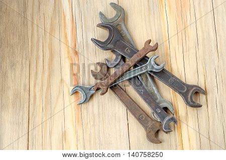 Old Work Tools Spanner, Wrench On A Wooden Table.