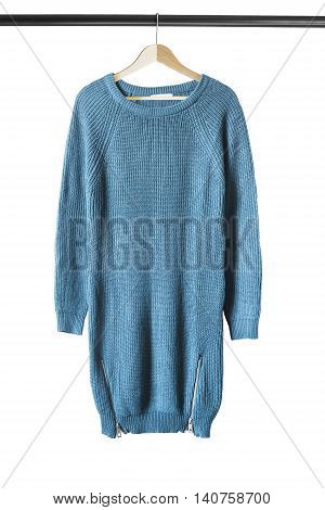 Blue knitted sweater on wooden clothes rack isolated over white