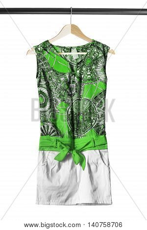 Green silk dress on wooden clothes rack isolated over white