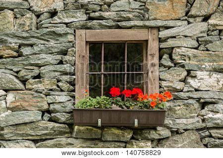 Old Window of the stone house in Alps Austria