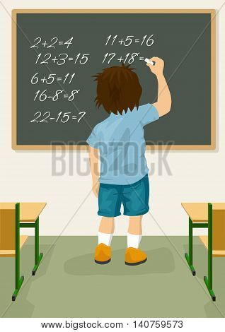 Back view of schoolboy solves arithmetical on a blackboard