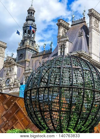 Paris, FRANCE-JULY 28, 2016: Globe sculpture in front of the City Hall in Paris - Hotel de Ville