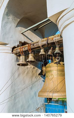 Bells in the span of the belfry of St Sophia Cathedral in Veliky Novgorod Russia - closeup view under sunlight