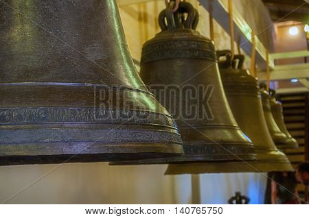 VELIKY NOVGOROD RUSSIA-JULY 29 2016. Bells at the exhibition inside the belfry of St Sophia Cathedral in Veliky Novgorod Russia - closeup view. Soft filter applied.