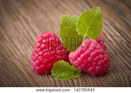 Fresh Raspberry close up on the wood table