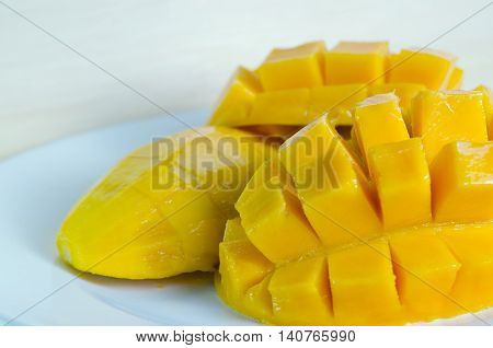 Mango Nicely Cut On Wooden Background (also Known As Horse Mango, Mangifera Foetida, Anacardiaceae,