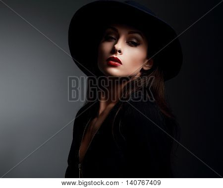 Elegant Makeup Woman In Fashon Hat And Red Lips Posing On Dark Shadow Background