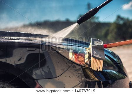 Close Up Of Nozzle Of High Pressure Washer Used On Car