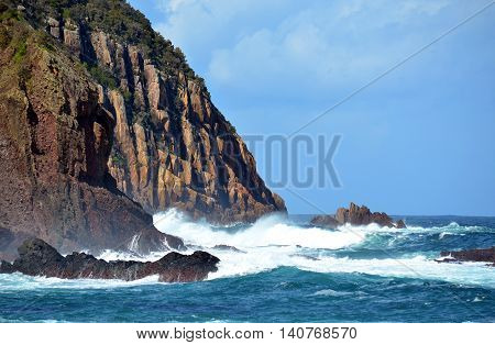 Rugged, rocky cliffs and wild surf near Port Stephens on the New South Wales coast, Australia