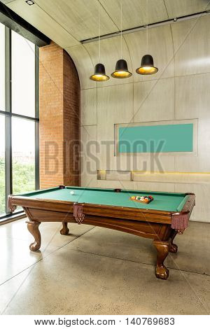 modern minimalism style wall with night lighting. Pool table.